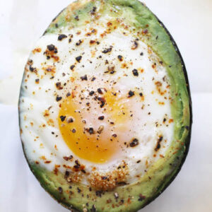 Baked egg with avocado and pepper.