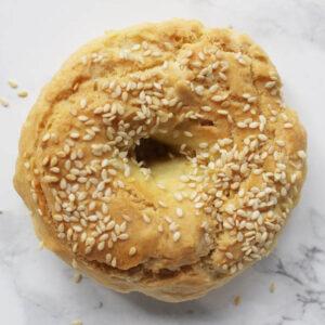 Gluten-Free Sesame Bagels on white marble backdrop.